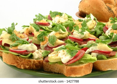 Close view at sandwiches with salami and other fresh ingredients