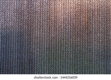 Close view of a screen used for privacy and heat absorption.