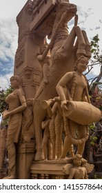 Close up view of sculptures of man playing a drum (thavil in tamil), playing a Shehnai (Nadaswaram in tamil), riding a horse, and an ancient woman greeting, with ruined structures chennai india tamil