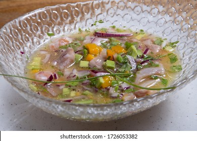 Close up view sea bass ceviche served in glass bowl wooden background. Fresh and tasty ceviche. Raw fish. Latin America cuisine.