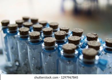 Close up view of several bottles sealed with cork stoppers.