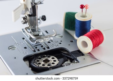 Close up view of sewing machine with threads, needle work concept