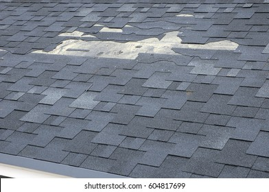 A close up view of shingles a roof damage.