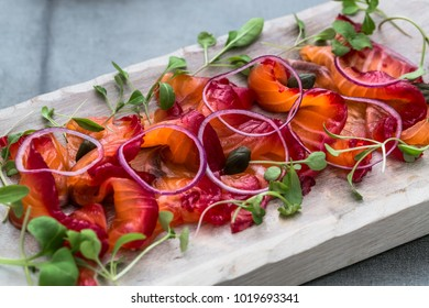 Close view sliced gravlax on a white cutting board