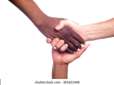 A close up view of a small group of men of mixed races holding hands in support