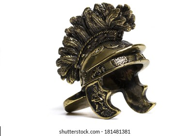 Close up view of small miniature roman helmet isolated on a white background.