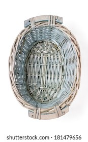 Close up view of a small wicker basket isolated on a white background.