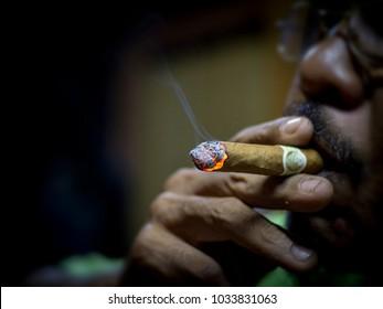 Close up view smoking of a cigar