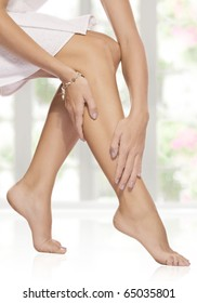 close up view of smooth woman�s legs on color  background