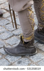 Close up view of some curved medieval shoes.