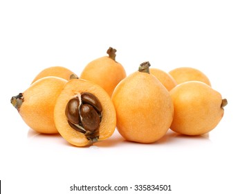 Close up view of some loquat fruit isolated on a white background