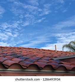 Close up view of a southwestern style tile roof on a beautiful sunny day