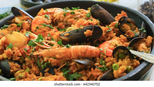 Close up view of a Spanish seafood paella: mussels, king prawns, langoustine, haddock