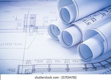 close up view stack of white construction blueprints with copyspace for your text
