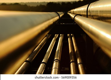 Close up view of steel golden pipes in oil refinery