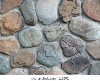 A close up view of a stone wall