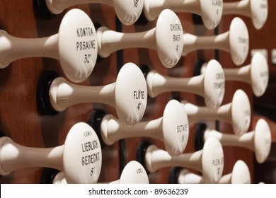 Close up view of the stop knobs of a church pipe organ.