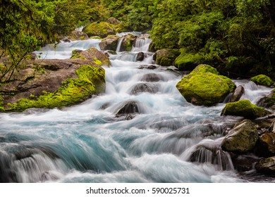 Close view of the stream that flows from Lake Marian to the Hollyford River in Fiordland National Park, New Zealand