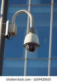 close up view of surveillance camera installed in business district
