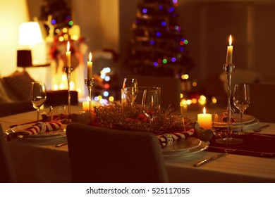 Close up view of table served for Christmas dinner, on blurred background