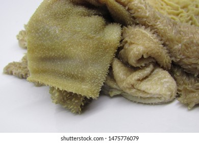 Close up view of tasty babat mentah or tripe,type of edible lining from the stomachs of various farm animals like kambing sapi domba ox cow.made from  muscle wall,interior mucosal lining is removed.