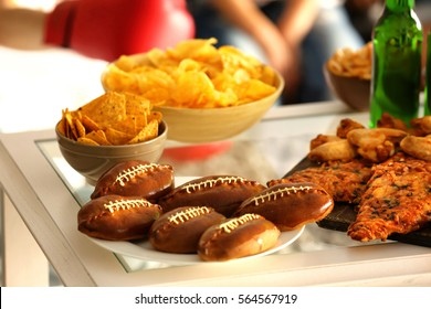 Close up view of tasty snacks and beer prepared for watching sports on TV