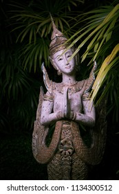 close up view of thai style statue on green back