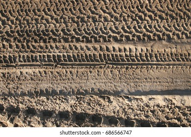 Close up View of Tire Tracks Prints in Sand