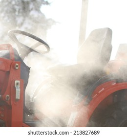 A close up view of a tractor in the fog.