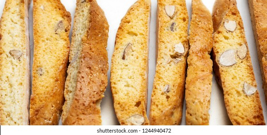 Close view of traditional Italian Almond cookies biscotti in row on light surface with copy space