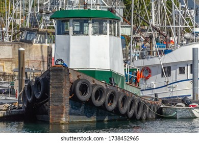 Close view of a tugboat docked in a marina in Sitka, Alaska, USA
