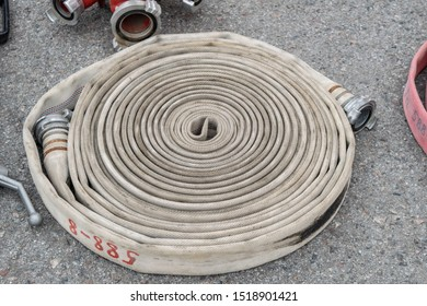 Close up view of twisted fire hose laying on the asphalt