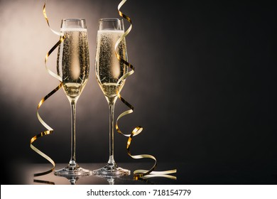 close up view of two glasses of champagne with ribbons