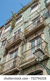"Close view of a typical house with wall tiles ""Azulejo"" in the old town of Lisbon in Portugal"