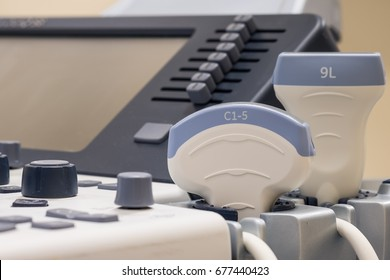 Close up view of an ultrasound machine with two transducers