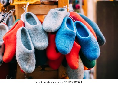 Close View Of Various Colorful European Felt Boots Or Slippers At Winter Christmas Market. Souvenir From Europe.