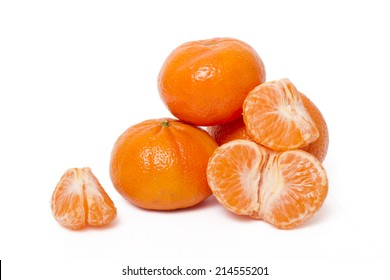 Close up view of vibrant tangerines fruits isolated on a white background.