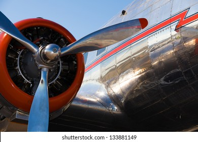 Close up view of a vintage propeller passenger and cargo airplane.