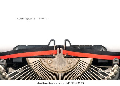 close view of vintage typewriter type bars ready to type a new story on a sheet  beginning with once upon a time