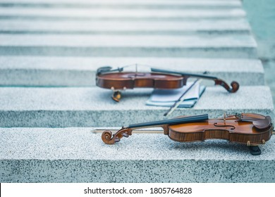 Close view of a violin strings and bridge. Violin in vintage style on outdood background. The violin on the table.