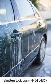 Close up view of Washing a car at the car wash