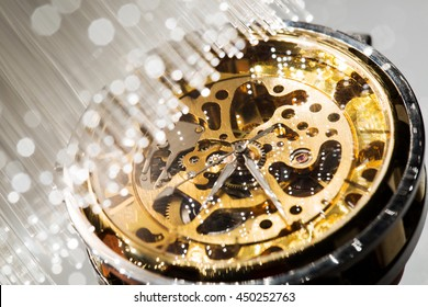 close view of watch mechanism and Fiber optics background