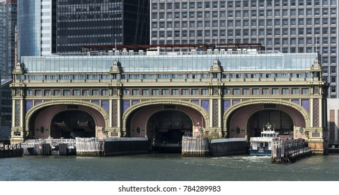 An up close view from the water of the Batery Maritime Building with a sightseeing boat entering it in new york city.