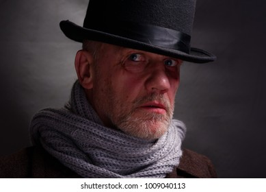 Close up view of a white, bearded, Victorian criminal.