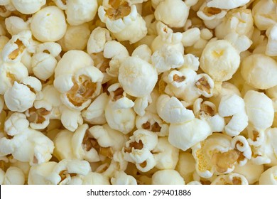 A close view of white cheddar cheese flavored popcorn.