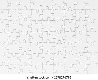 Close up view of white jigsaw puzzle background
