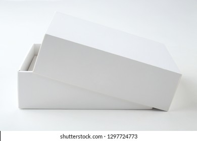 Close up view of white open cardboard gift box on white background