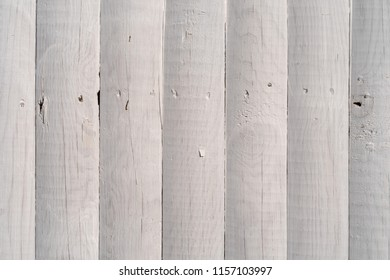 Close view of whitewashed cedar hewn log fencing.