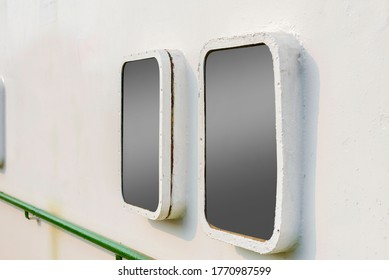 Close up view of the window on side of the ship