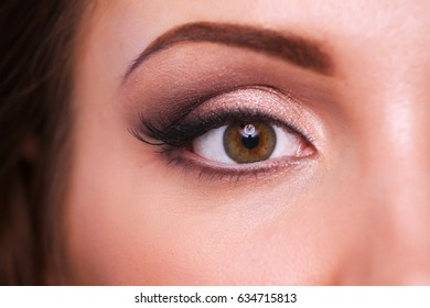 Close up view of woman eye with makeup